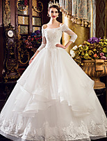 A-line Wedding Dress Floor-length Bateau Tulle with Appliques / Beading / Lace / Ruffle