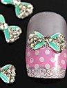 10st gröna korsning rhinestone fluga legering naglar tillbehör nagel konst dekoration