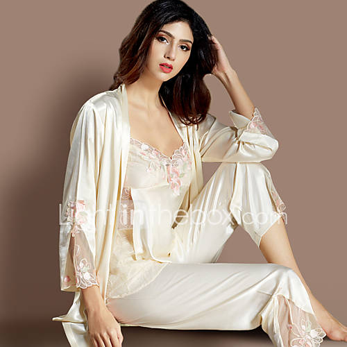Slide into style and comfort with this Women's Satin Pajama Set - Gilligan & O'Malley. This two-piece set of satin pajamas comes in beautiful prints and gorgeous solids. The top in this sleepwear set is a classic button-up style with a notched collar, chest pocket, long sleeves and coordinating piping that pops against the background.